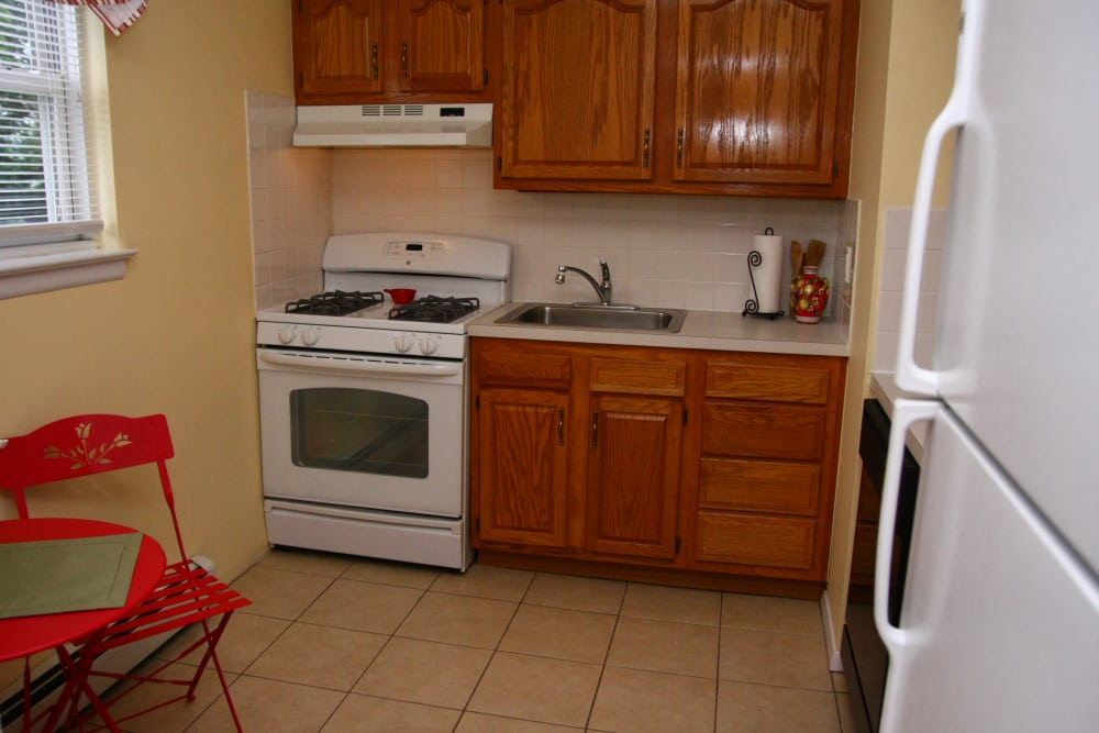 White appliances and lots of cabinet space in the kitchen at Washington Heights