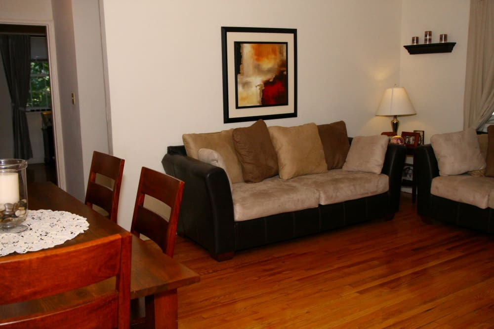 Living room setup at Linden Arms with a beige couch