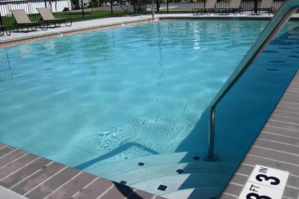 Beautiful pool area at River Rock Apartments in Spokane Valley, Washington