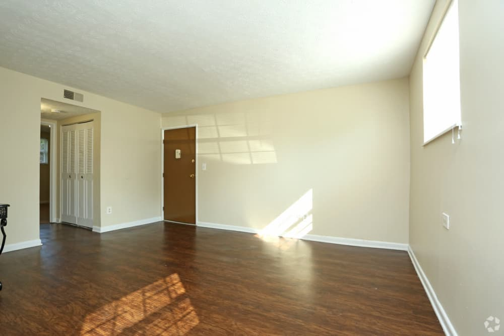 Spacious apartment homes with handsome hardwood flooring at King Solomon Apartments