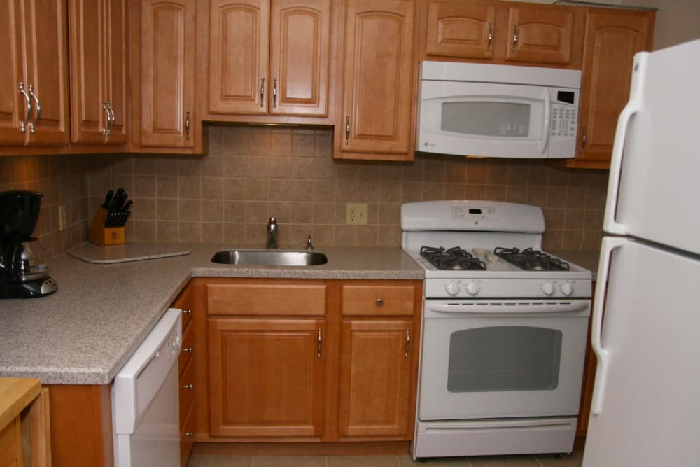 Model kitchen at Pompton Gardens features a gas stove range and lots of cabinet space