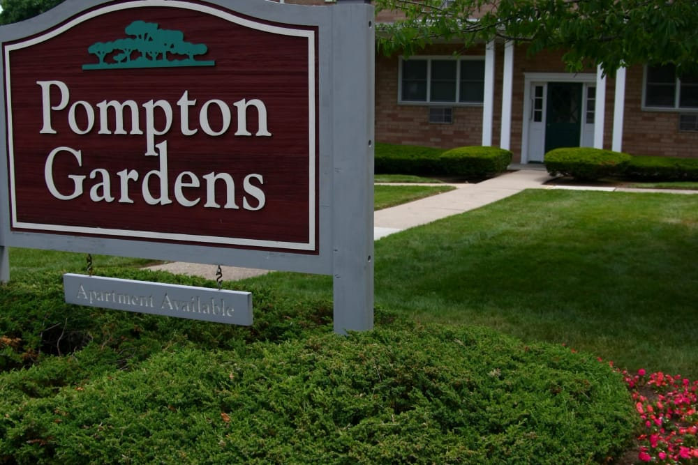 Close up of Pompton Gardens sign in Cedar Grove