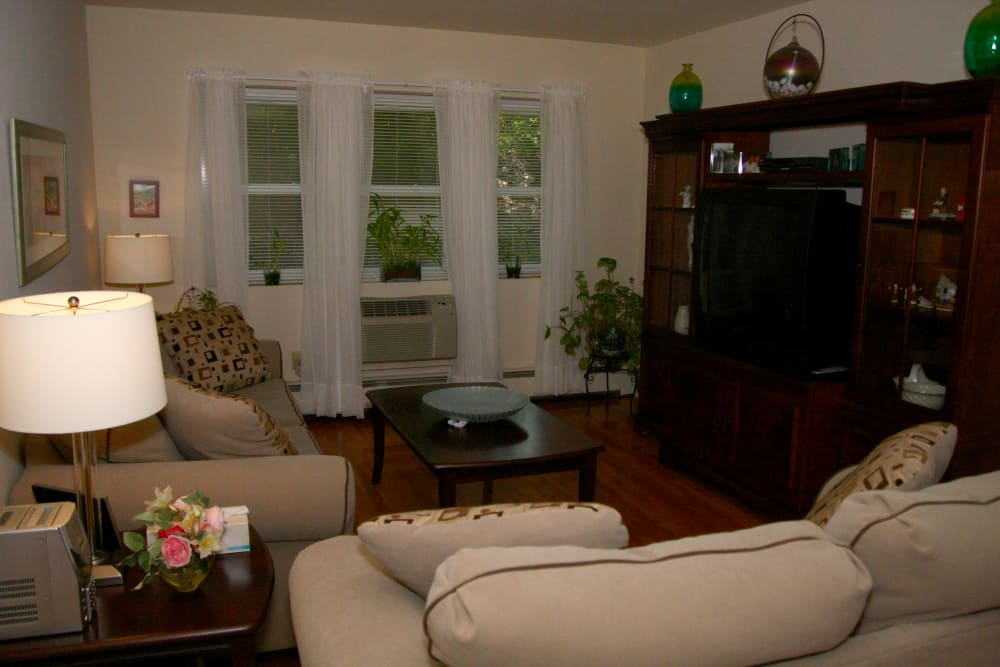 Windows in the living room at Pompton Gardens provide ample natural lighting