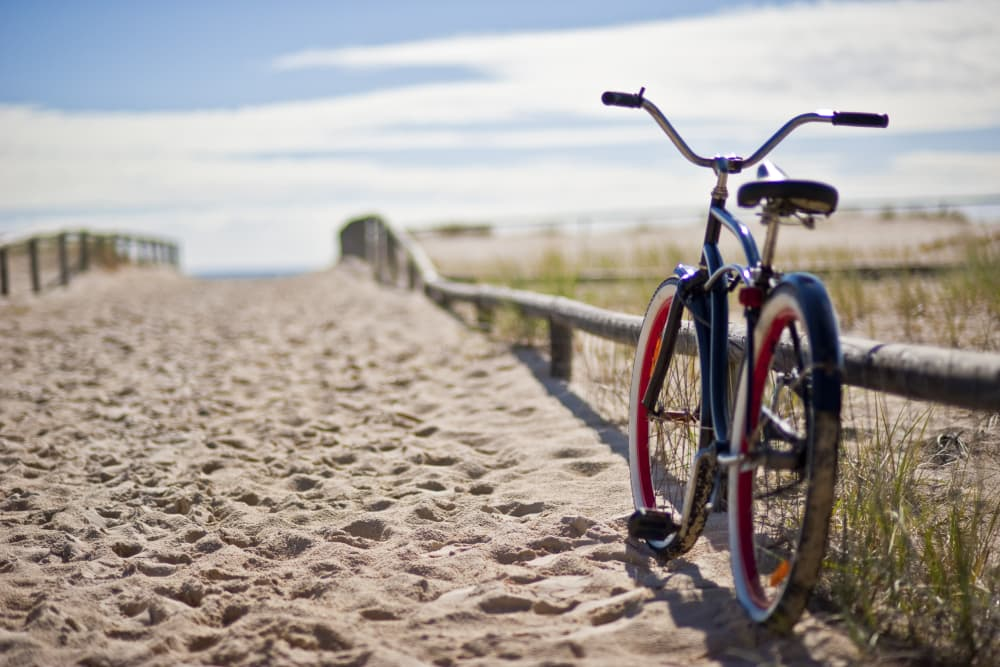 A bicycle on a sandy east coast beach
