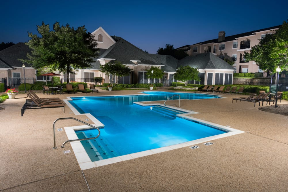 Night view of swimming pool at Ballantyne Apartments in Lewisville, Texas