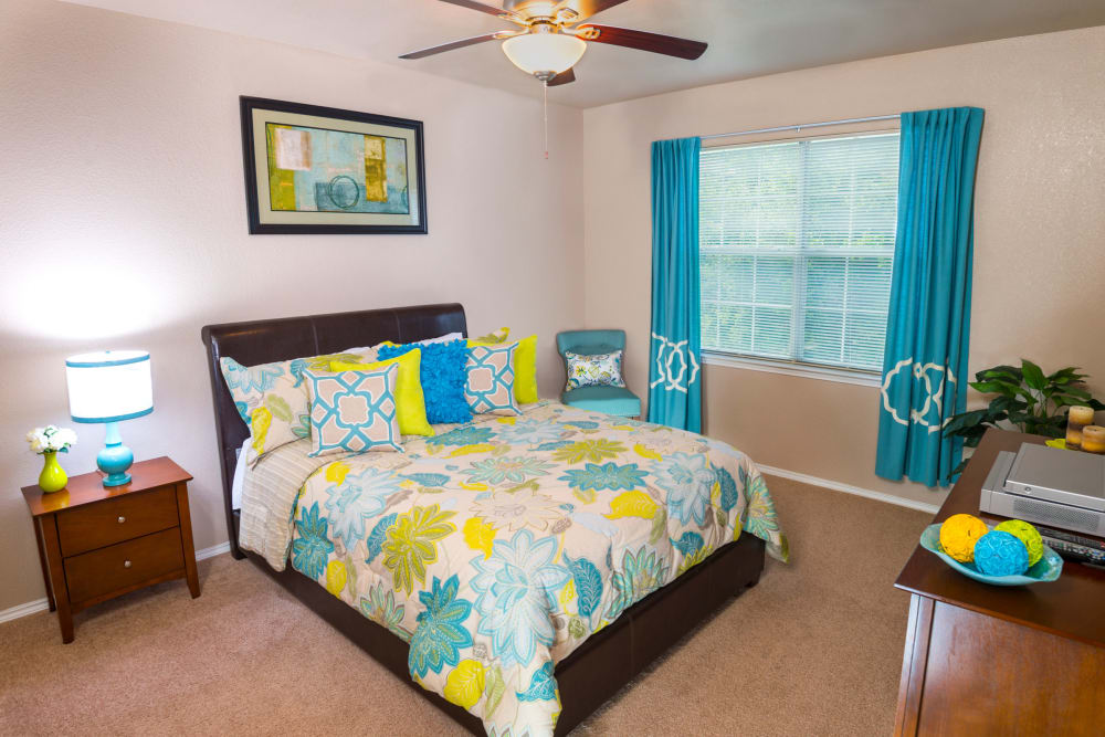Cozy bedroom at Ballantyne Apartments in Lewisville, Texas
