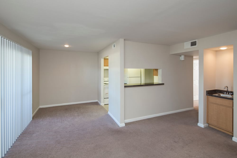 unfurnished living room and dining room at Morgan Bay in Houston, Texas