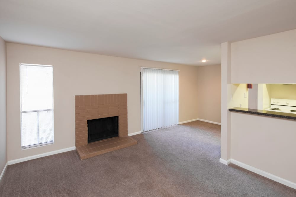 unfurnished living room with fireplace at Morgan Bay in Houston, Texas