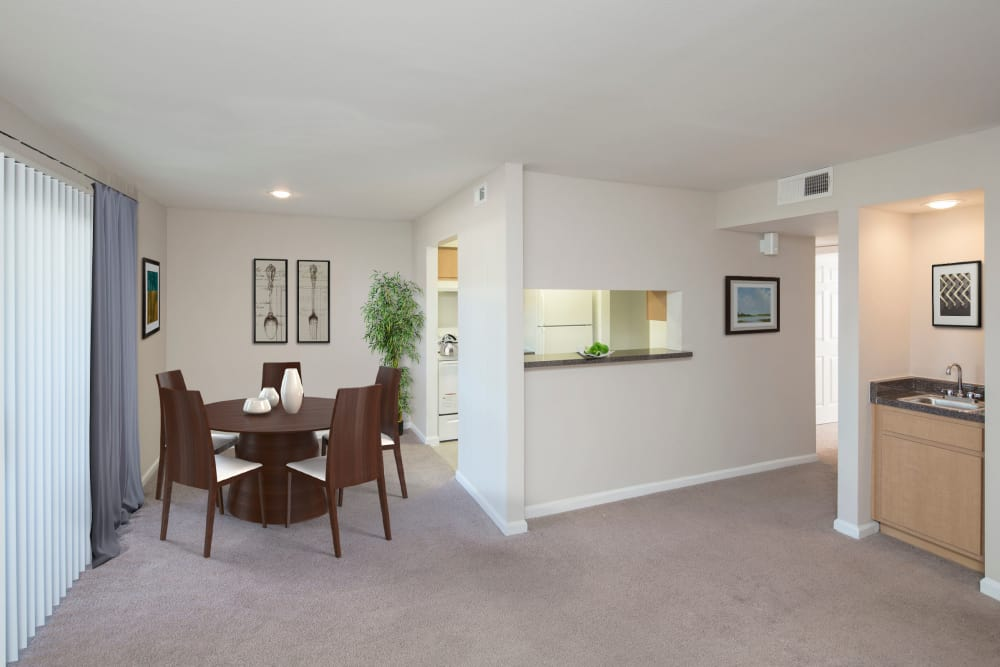 model furnished living room and dining area at Morgan Bay in Houston, Texas