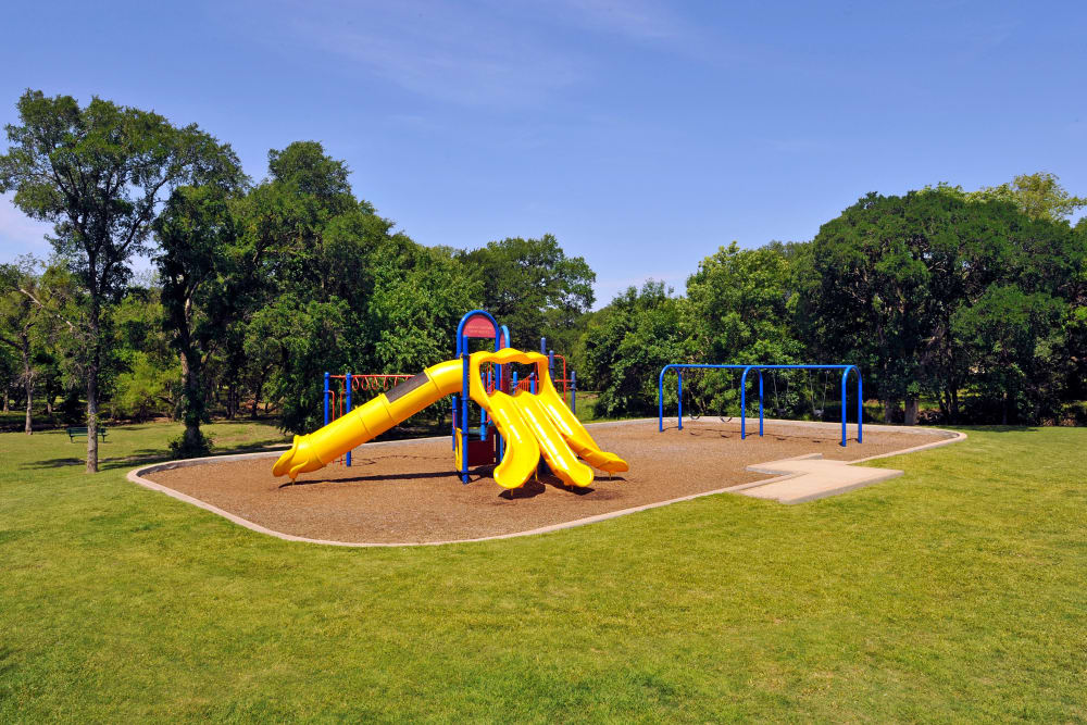 Playground at apartments at Carrollton Park of North Dallas in Dallas, Texas