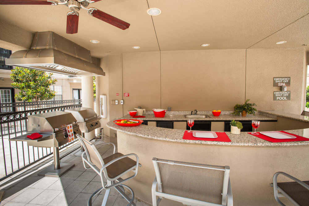 bbq area by the pool at Chateau de Ville in Farmers Branch, Texas
