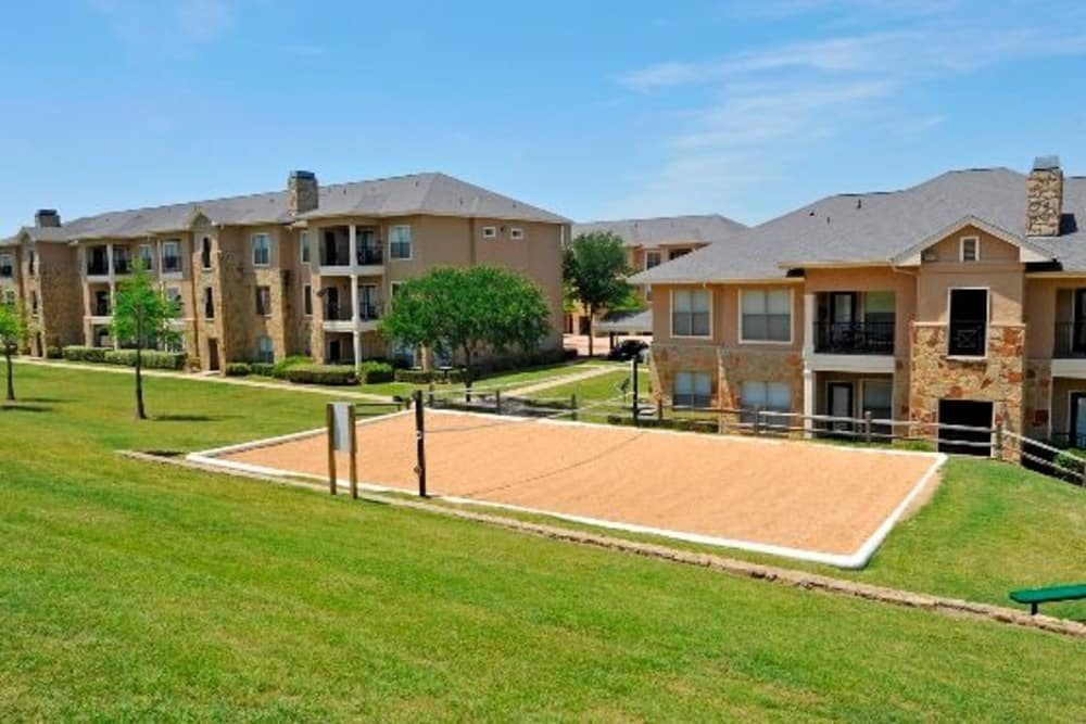Sand volleyball court at El Lago Apartments in McKinney, Texas