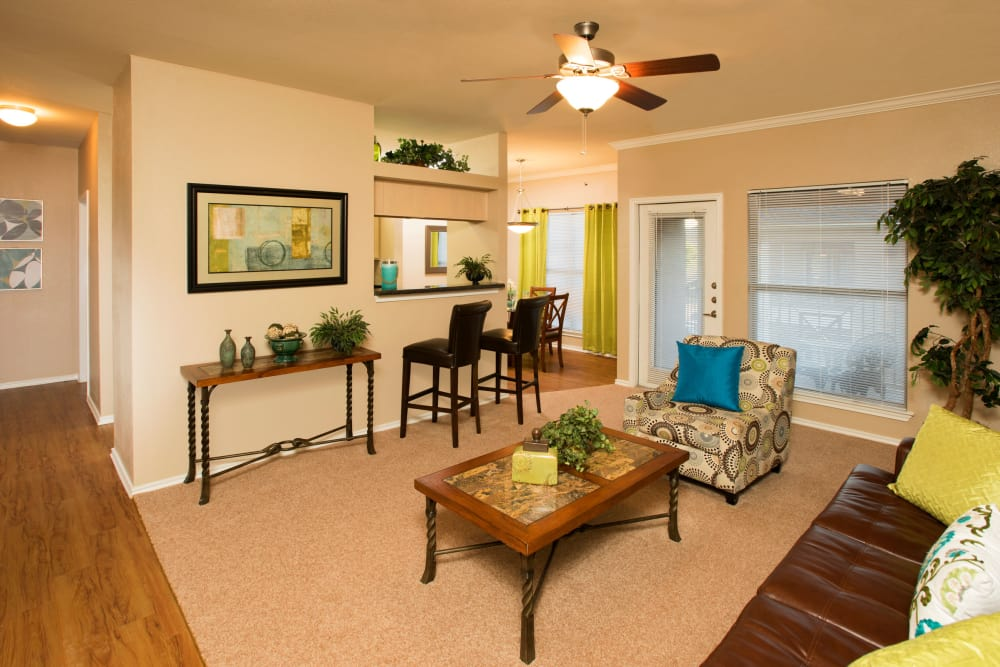 El Lago Apartments offers a naturally well-lit living room in McKinney, Texas