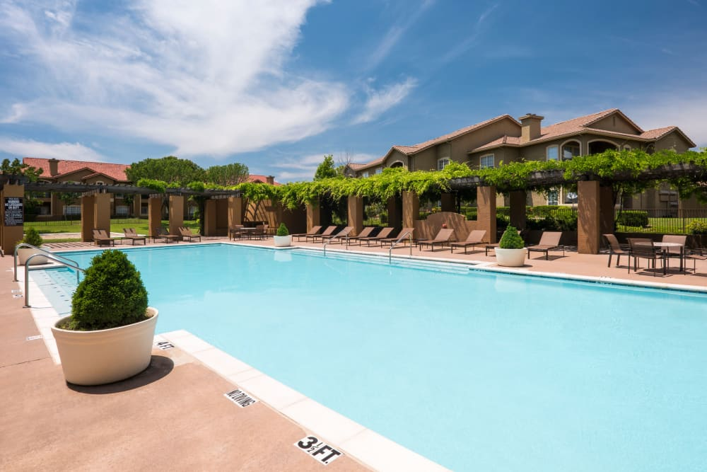 Enjoy apartments with a spacious swimming pool at Estates on Frankford in Dallas, Texas