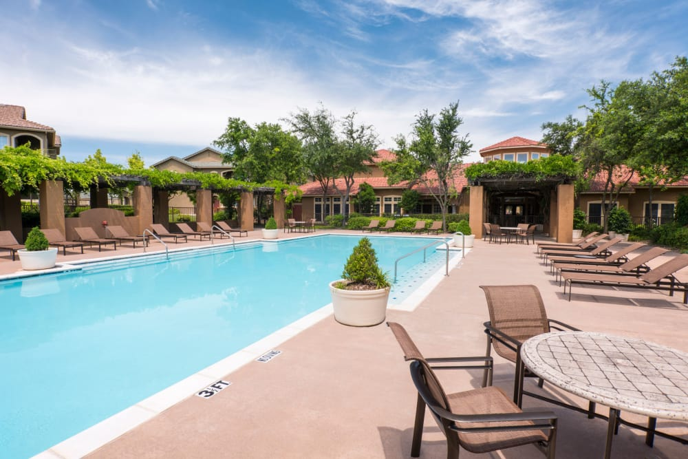 Swimming pool and sundeck area at Estates on Frankford in Dallas, Texas
