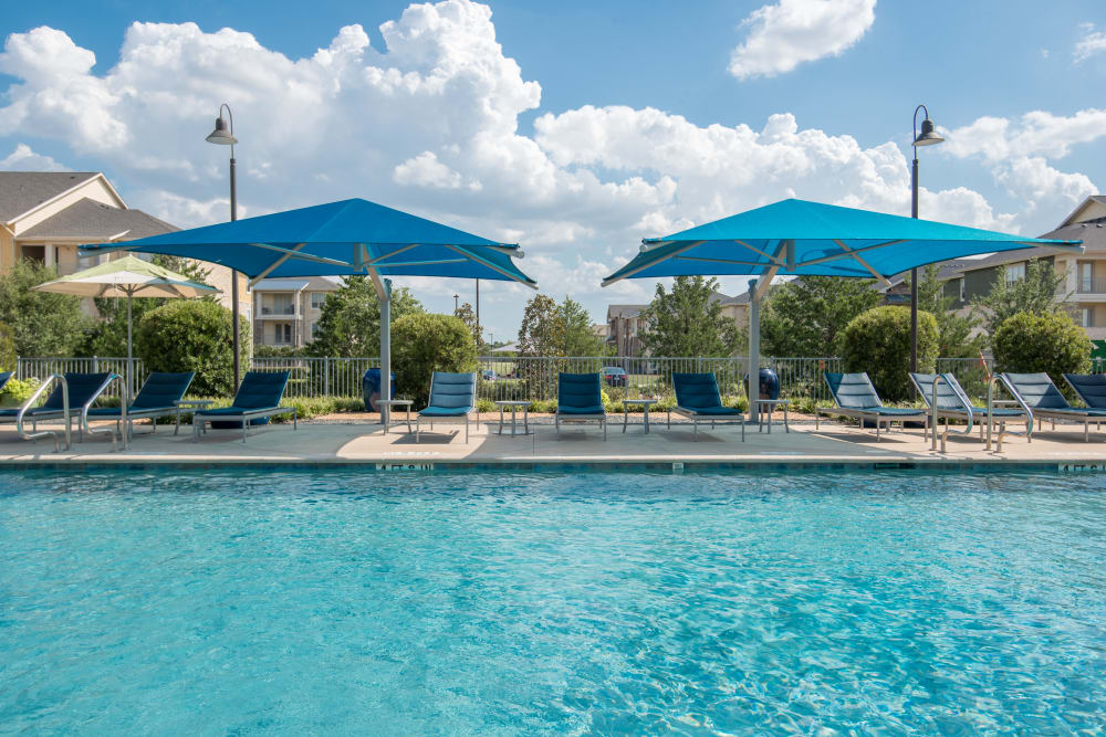 Enjoy apartments with a spacious swimming pool at Estates of Richardson in Richardson, Texas