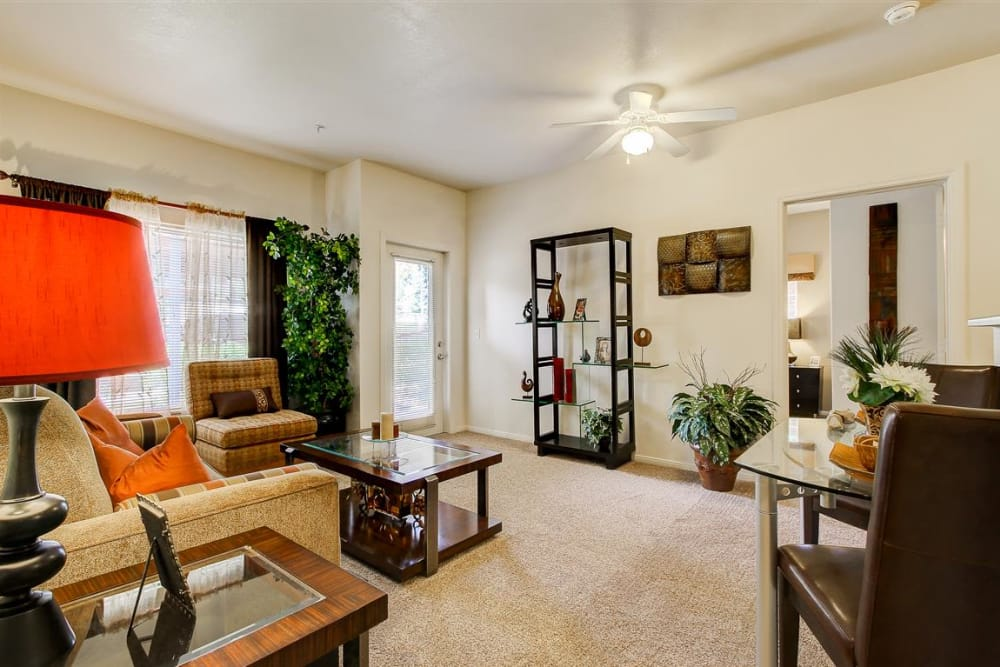 Ceiling fan and plenty of natural light in model living room at Sterling Pointe in Flagstaff, AZ