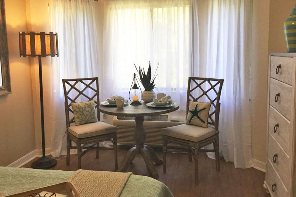 Tables by windows at Grand Villa of Englewood in Florida