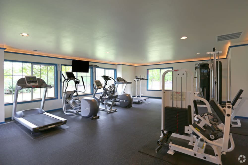 Modern fitness center at Conifer Place Apartments in Corvallis, Oregon