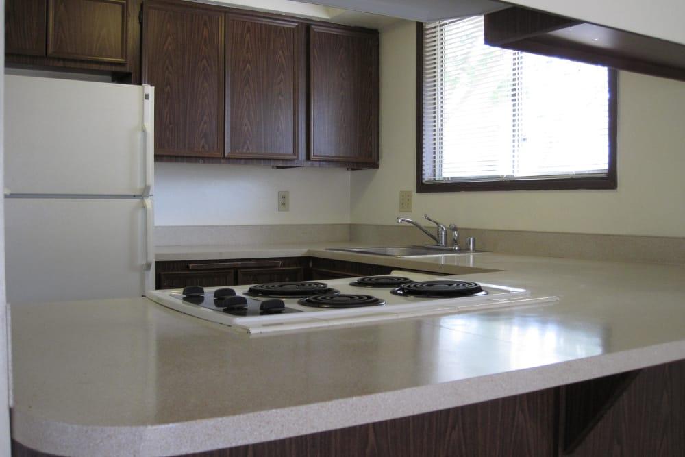 Kitchen with white appliances at Shasta Park in Eugene, Oregon