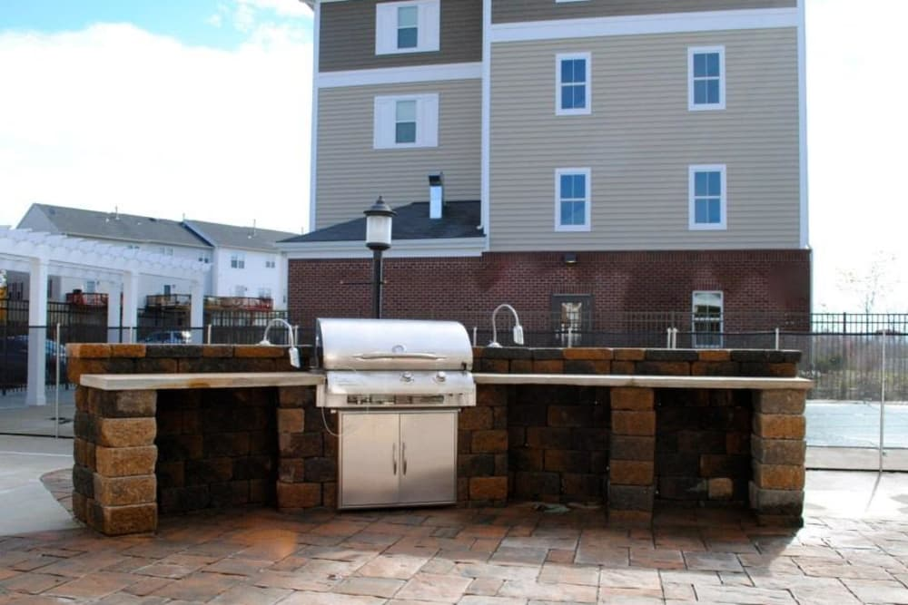 Modern bbq area at Orchard Meadows Apartment Homes in Ellicott City, Maryland