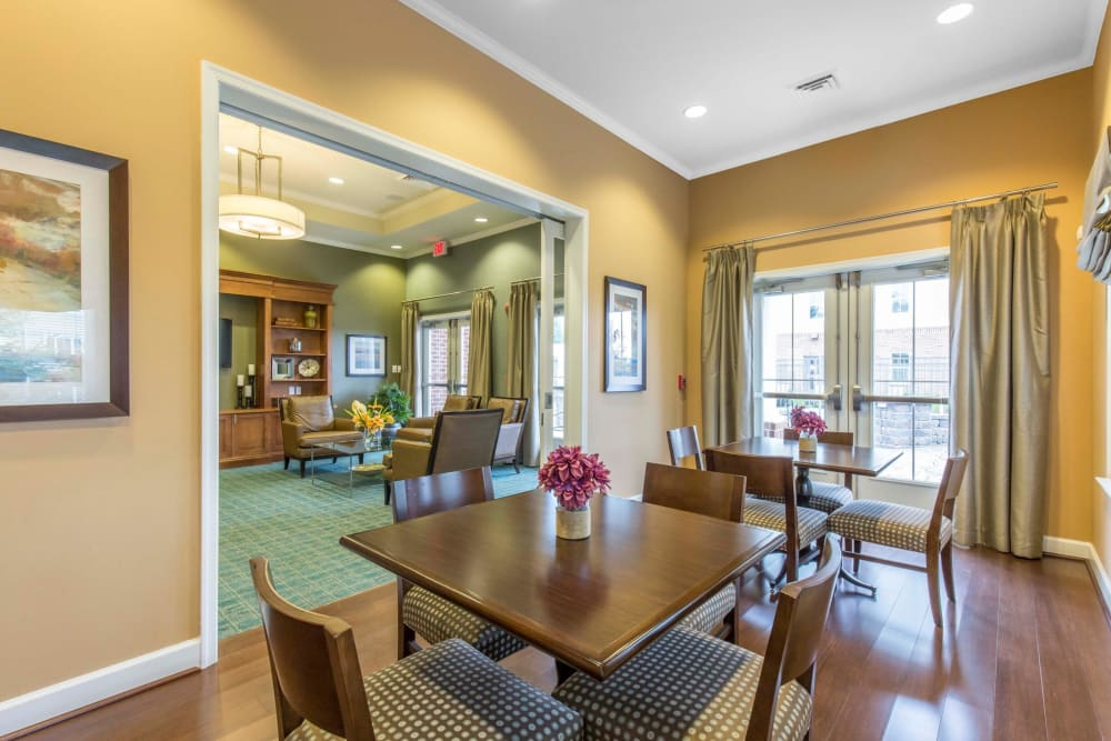 Dining tables at Orchard Meadows Apartment Homes in Ellicott City, Maryland