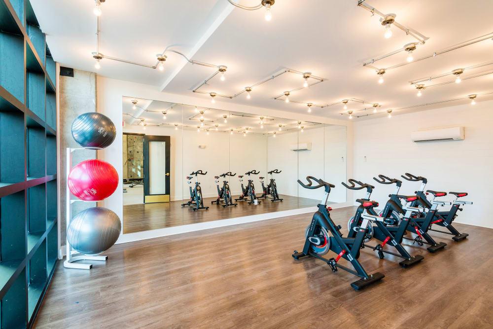 Rendering of the fitness center at Olmsted Nashville showing large windows for plenty of natural light