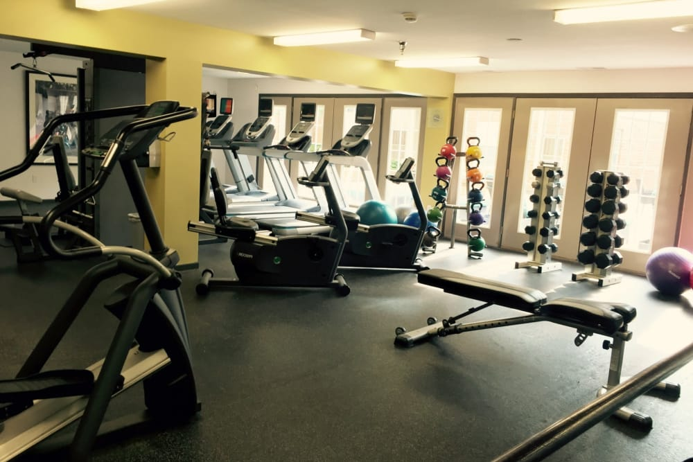 A fitness center with individual workout stations at Loring Park Apartments in Minneapolis, Minnesota