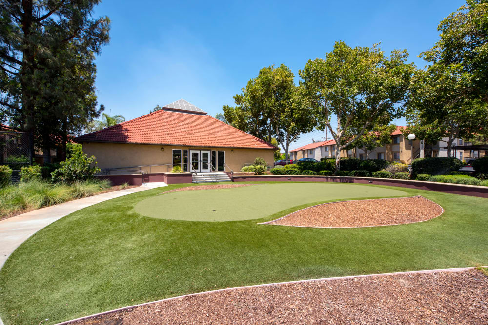 The exterior of the clubhouse and putting green at Alvista Terrace