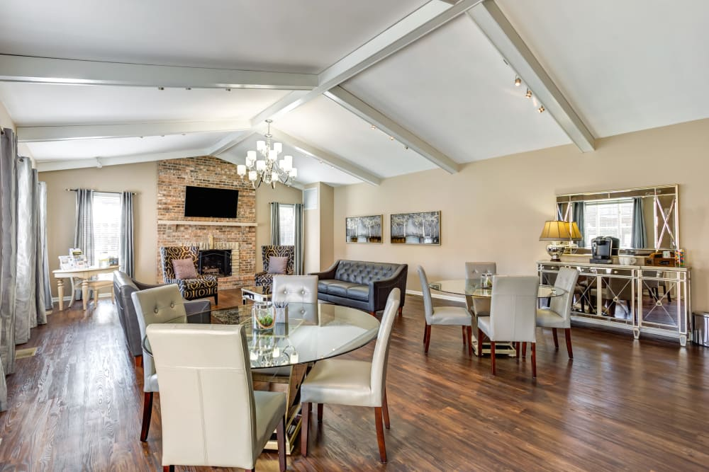 Resident lounge with wood-style flooring at Aspen Place in Aurora, Illinois