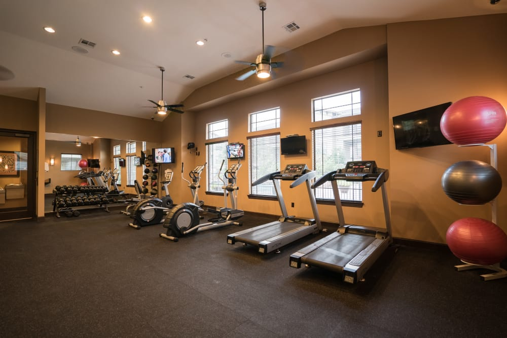 Modern fitness center at Queenston Manor Apartments in Houston, Texas