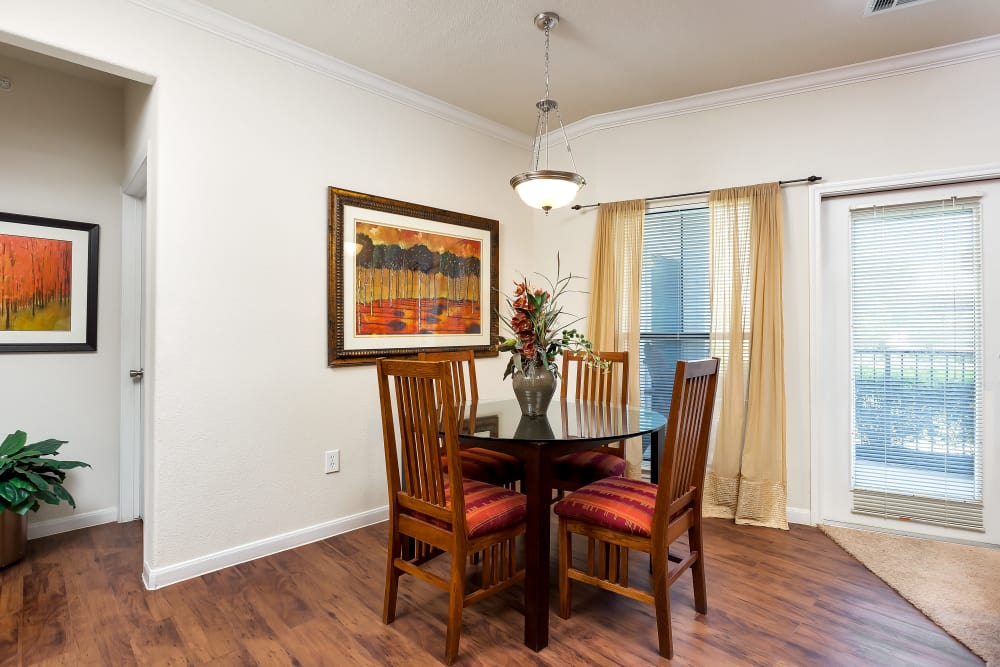 Dining room with wood-style flooring at Onion Creek Luxury Apartments in Austin, Texas