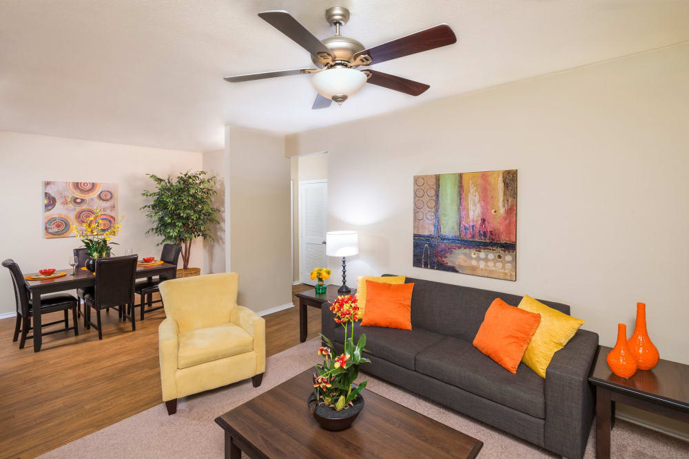 Stoneybrook Apartments & Townhomes offers a naturally well-lit living room in San Antonio, Texas
