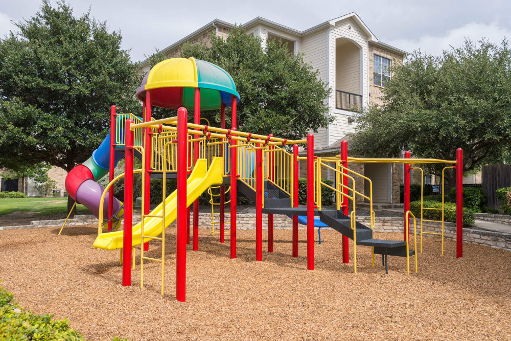 Well-maintained playground at Stoneybrook Apartments & Townhomes in San Antonio, Texas