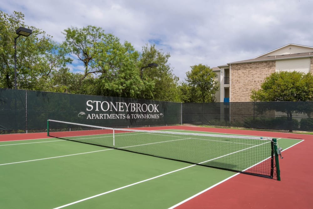 At Stoneybrook Apartments & Townhomes in San Antonio, Texas offer a tennis court