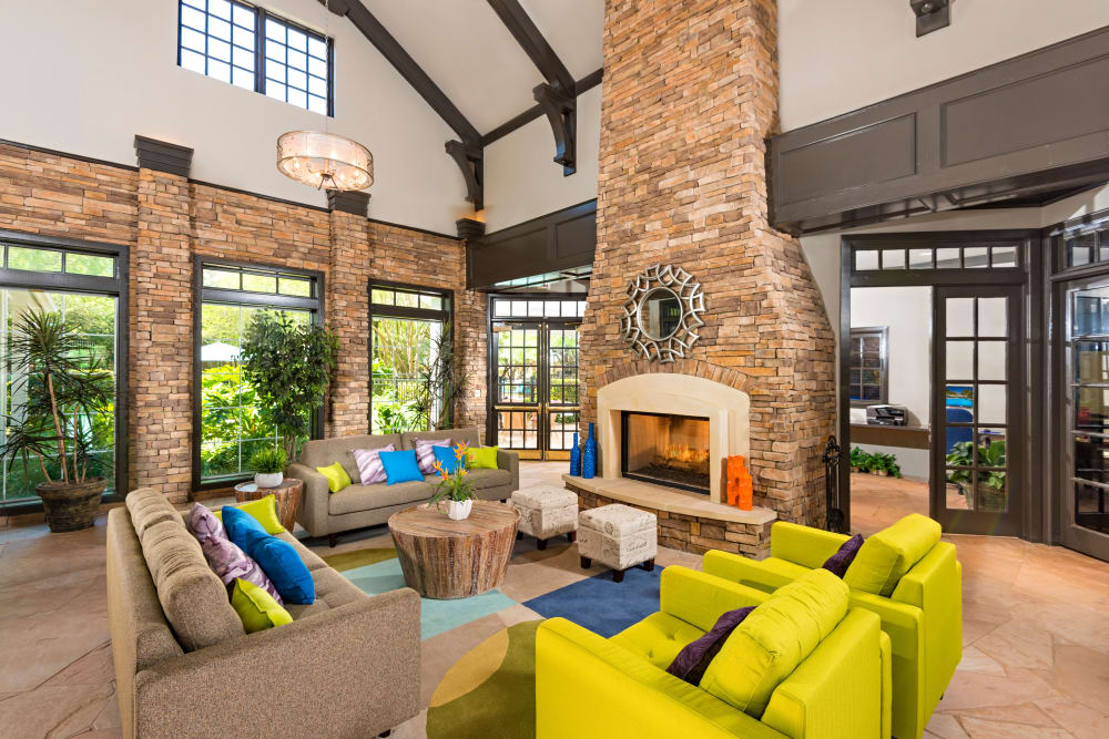 Beautiful living room with fireplace at The Lodge at Shavano Park in San Antonio, Texas
