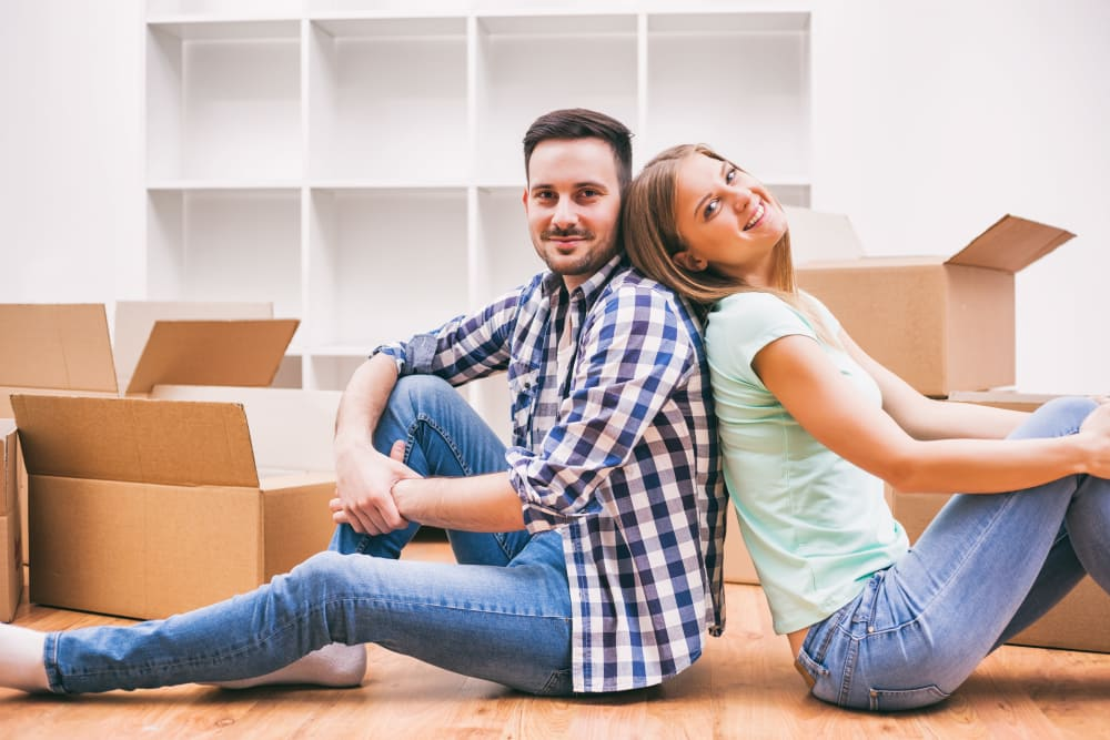 Couple resting after packing items to store at Monster Self Storage in Orangeburg, South Carolina