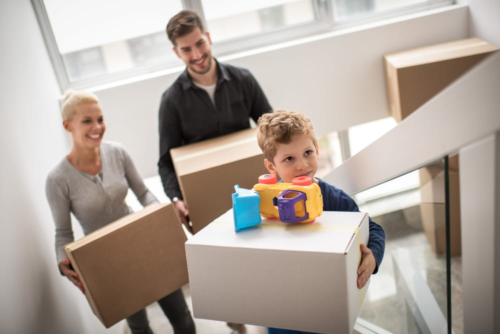 Family packing up boxes to store at Monster Self Storage in Summerville, South Carolina