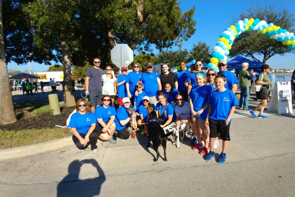 A group of people posing for a photo at a hunger walk near Discovery Senior Living in Bonita Springs, Florida