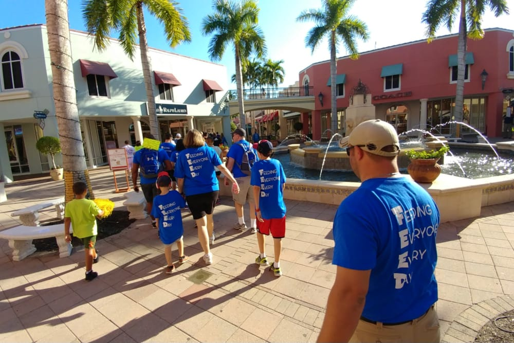 A group of people at the hunger walk near Discovery Senior Living in Bonita Springs, Florida
