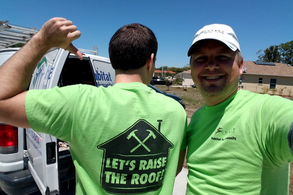 Two people with matching habitat for humanity t-shirts near Discovery Senior Living in Bonita Springs, Florida