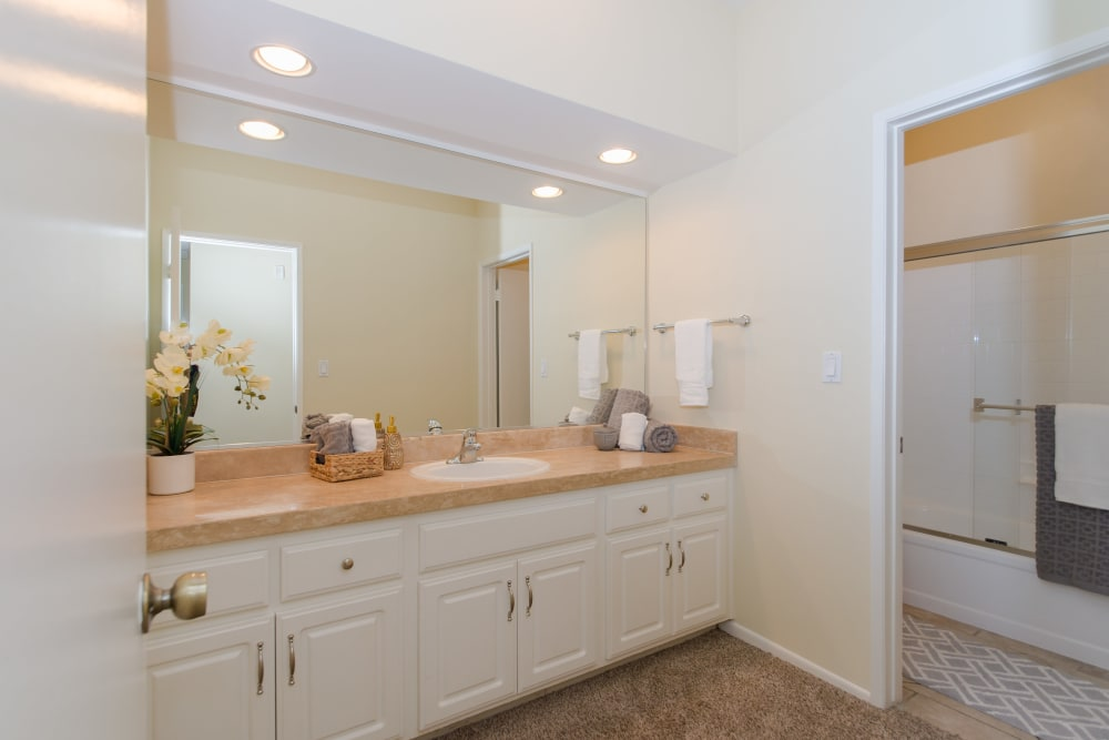 Bathroom with large vanity mirror in model home at IMT Beverly Arnaz in Los Angeles, California