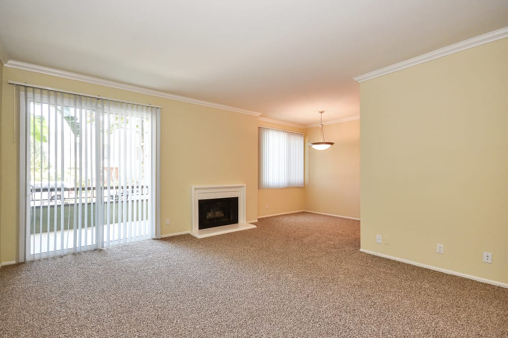 Plush carpet and fireplace in model home at IMT Beverly Arnaz in Los Angeles, CA