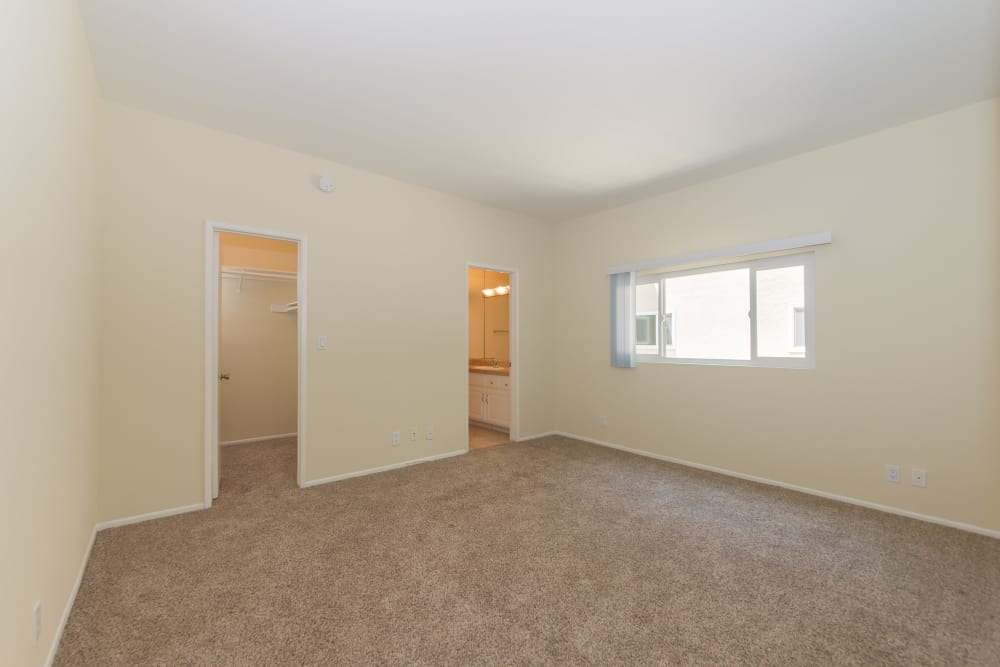 Large bedroom with plenty of natural light in model home at IMT Beverly Arnaz in Los Angeles, CA