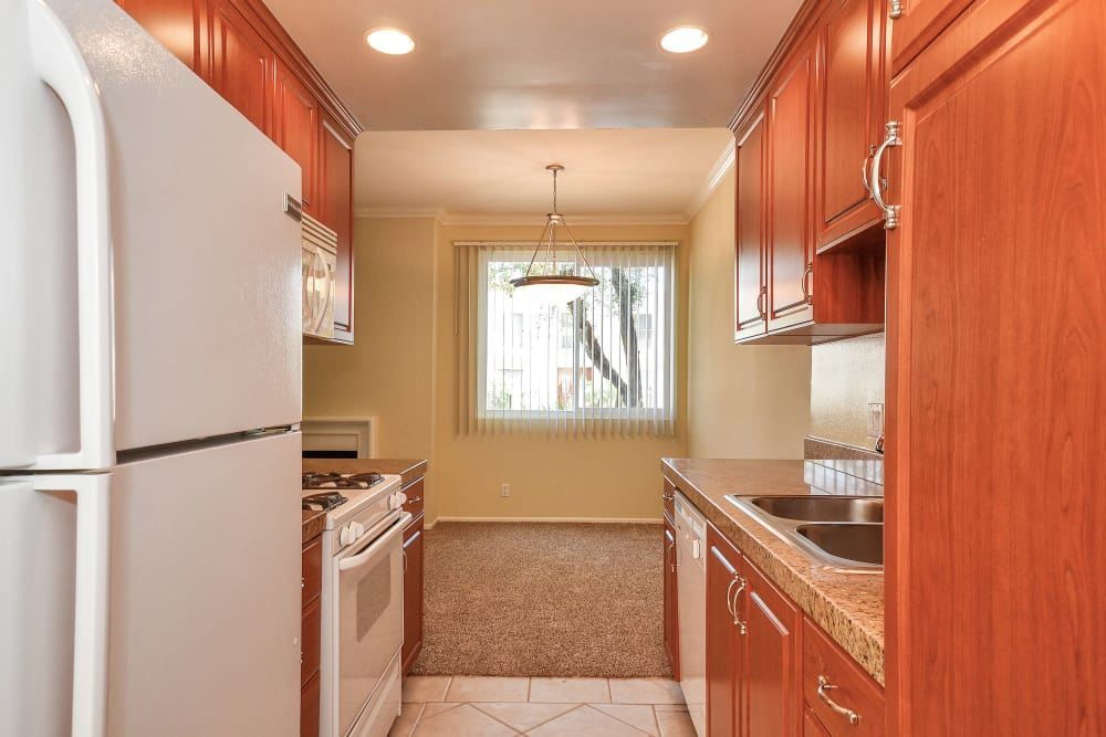 Cherry wood cabinets in modern kitchen at IMT Beverly Arnaz in Los Angeles, CA