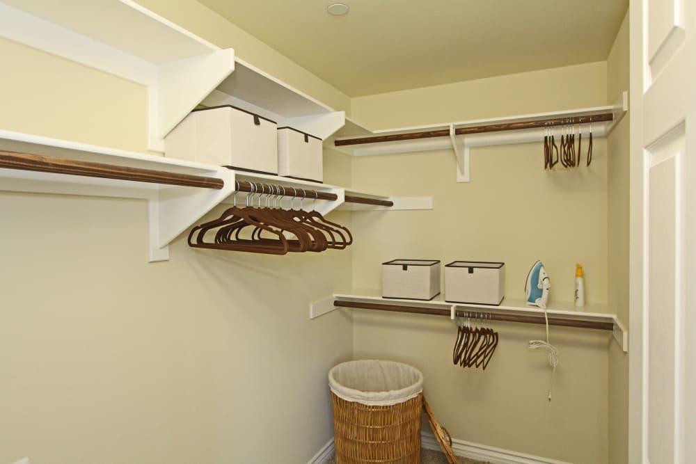 Spacious walk-in closet in model home bedroom at IMT Magnolia in Sherman Oaks, CA