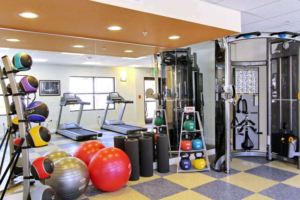 Plenty of equipment and machines to help you get fit in the fitness center at IMT Magnolia in Sherman Oaks, CA