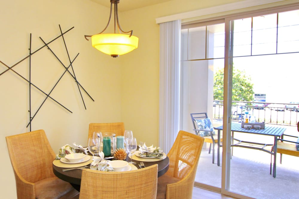 Dining area looking out onto private balcony in model home at IMT Magnolia in Sherman Oaks, CA