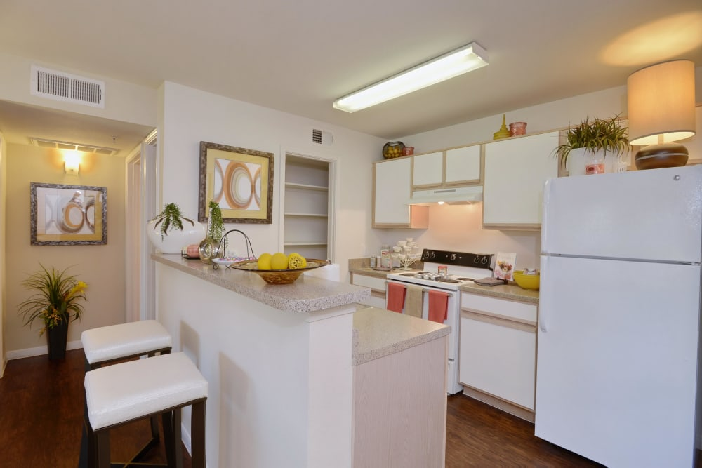 Well-decorated model kitchen and breakfast bar in model home at IMT At The Medical Center in Houston, Texas