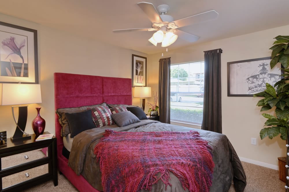 Master bedroom with luxurious furniture in model home at IMT At The Medical Center in Houston, Texas